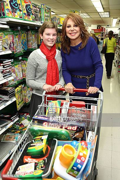 St Jude patient Mary Browder age 11 and St Jude National Outreach Director Marlo Thomas stock shopping carts full of Kmart Fab 15 toys while on a...