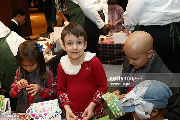 St Jude patients attend an evening hosted by Brooks Brothers to celebrate the holidays with St Jude Children's Research Hospital at Brooks Brothers...