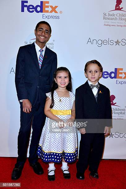 St Jude Patients Christopher Quinones Crista Anleu and Nicolas Maxwell attends the FedEx / St Jude Angels and Stars Gala at Hotel InterContinental on...