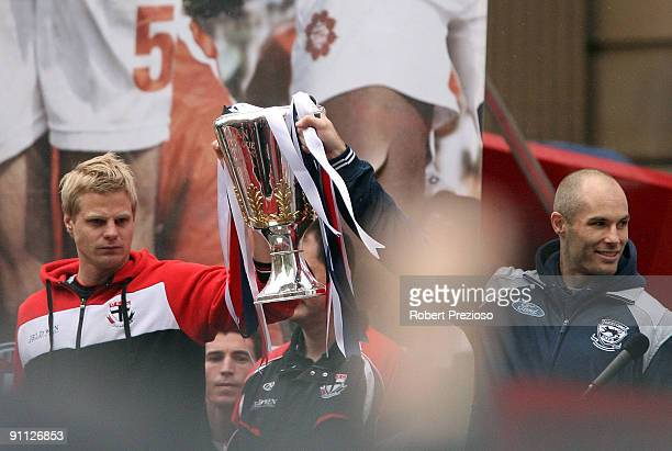 St Kilda Captain Nick Reiwoldt and Geelong Captain Tom Harley hold up the AFL Premiership Cup during the AFL Grand Final parade at Treasury Place on...