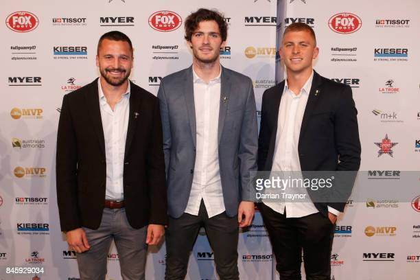 St Kilda players Jarryn Geary Dylan Roberton and Sebastian Ross arrive ahead of the AFL Players' MVP Awards at Shed 14 Central Pier on September 12...
