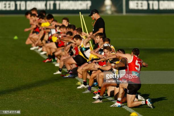 St Kilda players warm up during a St Kilda Saints AFL training session at RSEA Park on June 03, 2021 in Melbourne, Australia.