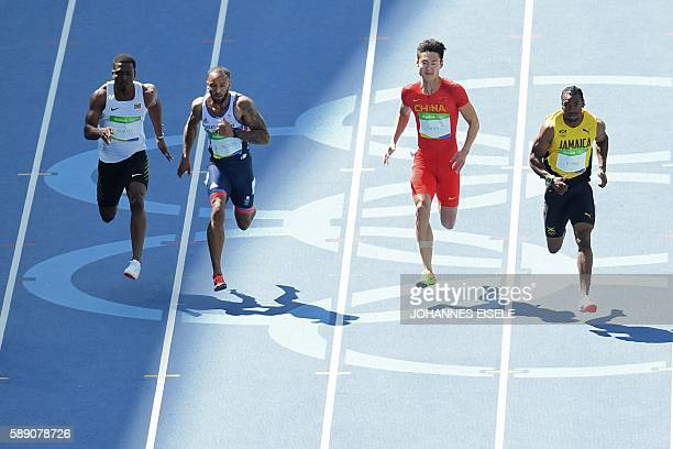 St Kitts and Nevis's Antoine Adams Britain's James Ellington China's Zhang Peimeng and Jamaica's Yohan Blake compete in the Men's 100m Round 1 during...