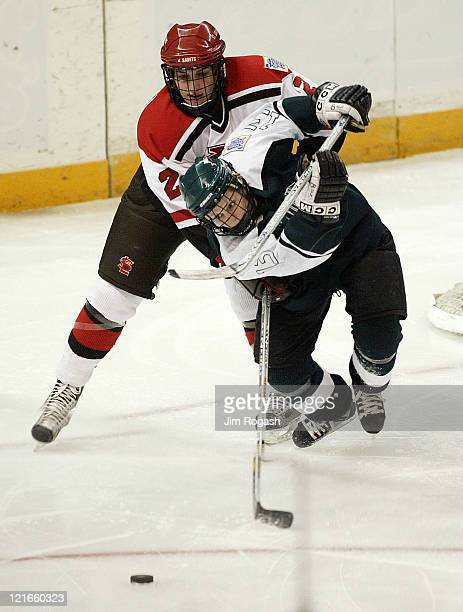 St. Lawrence's Lindsay Charlebois, behind, chases Dartmouth's Krista Dornfried during the consolation round of the NCAA 2004 Women's Frozen Four at...