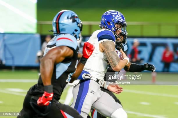 St Louis Battlehawks quarterback Jordan Ta'amu is chased by Dallas Renegades cornerback Treston Decoud during the game between the Dallas Renegades...