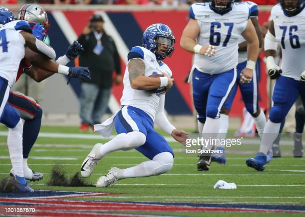St Louis Battlehawks quarterback Jordan Ta'amu slides on the carry of the ball during the XFL game between the St Louis BattleHawks and Houston...