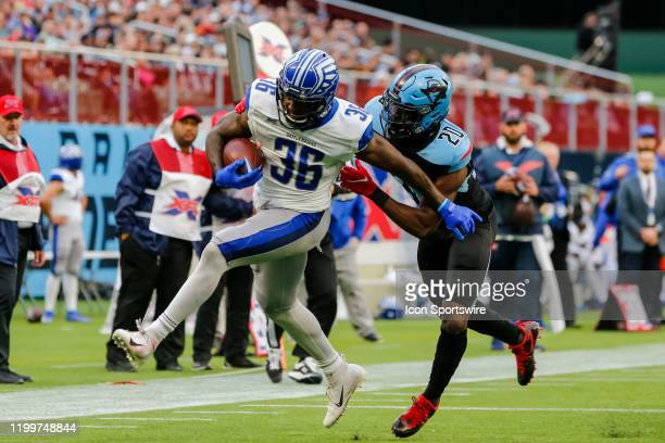 St Louis Battlehawks running back Keith Ford scores a touchdown over Dallas Renegades safety Tenny Adewusi during the game between the Dallas...