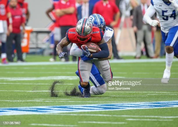St Louis Battlehawks safety Dexter McCoil tackles Houston Roughnecks wide receiver Kahlil Lewis during the XFL game between the St Louis BattleHawks...