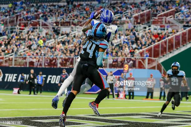 St Louis Battlehawks wide receiver Alonzo Russell catches a touchdown pass over Dallas Renegades cornerback Treston Decoud during the game between...