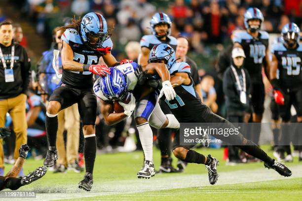 St Louis Battlehawks wide receiver De'Mornay PiersonEl gets tackled by Dallas Renegades safety Micah Abernathy and cornerback Donatello Brown during...