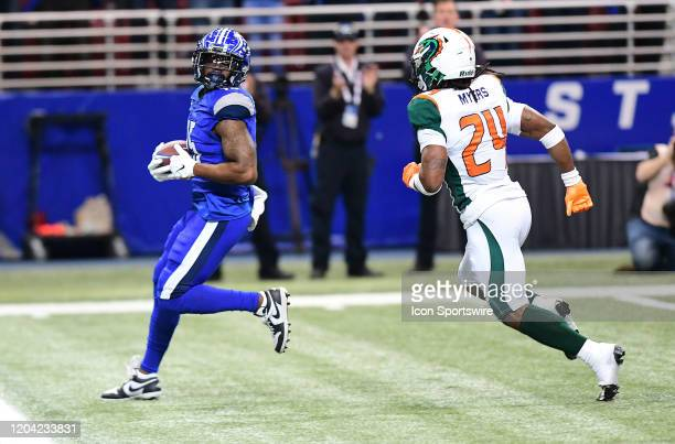 St Louis BattleHawks wide receiver De'Mornay PiersonEl looks back at Seattle Dragons cornerback Marko Myers before scoring during an XFL game between...