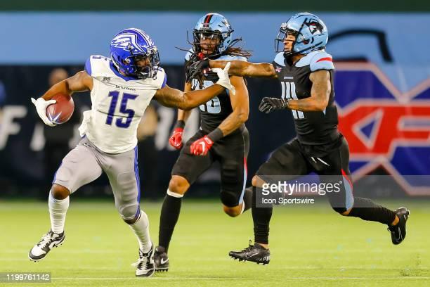 St Louis Battlehawks wide receiver De'Mornay PiersonEl stiff arms Dallas Renegades cornerback Dashaun Phillips as cornerback Donatello Brown chases...