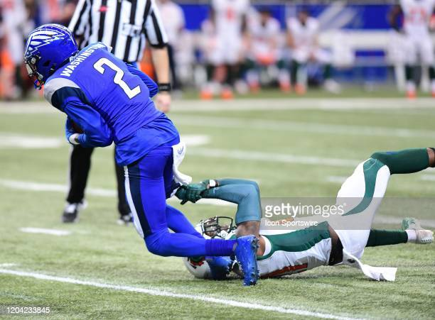 St Louis BattleHawks wide receiver LDamian Washington is tackled by Seattle Dragons cornerback Mohammed Seisay during an XFL game between the Seattle...