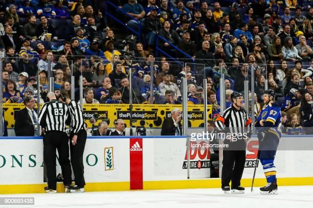 St Louis Blues' Alex Pietrangelo far right and referee Dean Morton right talk while linesmen Matt MacPherson far left and Ryan Daisy left review a...