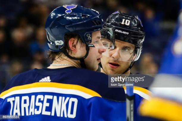 St Louis Blues' Brayden Schenn center discusses strategy with Vladimir Tarasenko left during the third period of an NHL hockey game between the...