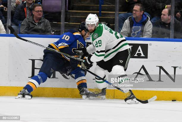 St Louis Blues center Brayden Schenn and Dallas Stars defenseman Greg Pateryn compete for the puck on the boards during a NHL game between the Dallas...