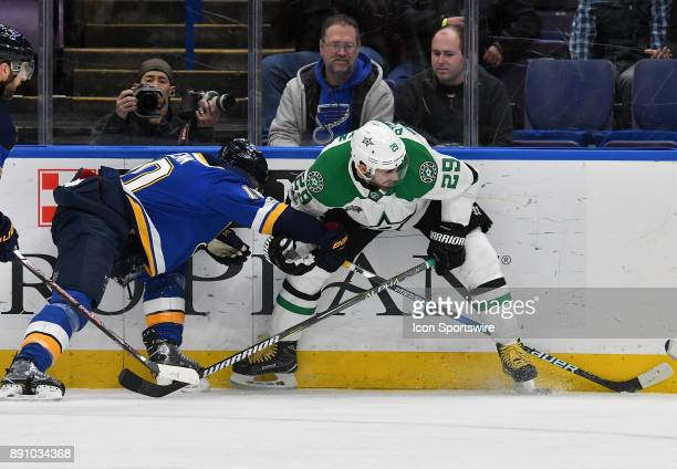 St Louis Blues center Brayden Schenn and Dallas Stars defenseman Greg Pateryn battle for the puck on the boards during a NHL game between the Dallas...