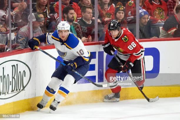 St Louis Blues center Brayden Schenn battles with Chicago Blackhawks right wing Patrick Kane during the game between the Chicago Blackhawks and the...