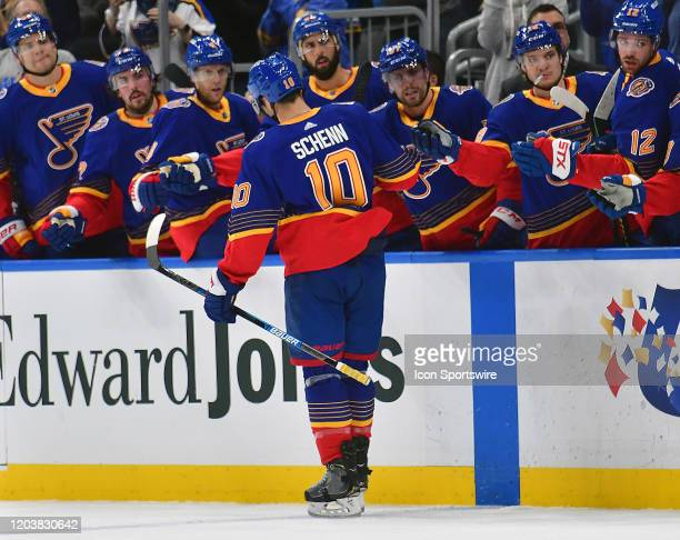 St Louis Blues center Brayden Schenn is congratulated by teammates after scoring in the first period during an NHL game between the New York...