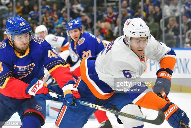 St Louis Blues center Ivan Barbashev and New York Islanders defenseman Ryan Pulock go after a loose puck during an NHL game between the New York...