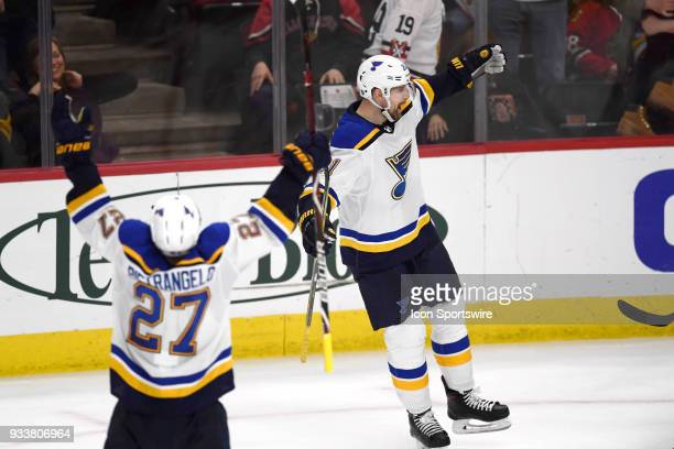 St Louis Blues center Patrik Berglund celebrates with teammates after scoring the winning goal in overtime play during a game between the Chicago...
