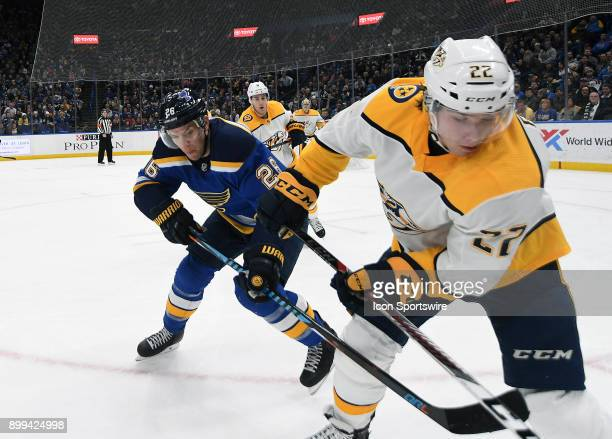 St Louis Blues center Paul Stastny and Nashville Predators leftwing Kevin Fiala battle for the puck on the boards during a NHL game between the...