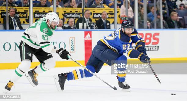 St Louis Blues defenseman Alex Pietrangelo passes the puck while being pressured by Dallas Stars right wing Alexander Radulov in the first period on...