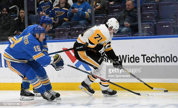 St Louis Blues defenseman Jay Bouwmeester reaches in to knock away the puck from Pittsburgh Penguins center Evgeni Malkin during an NHL game between...