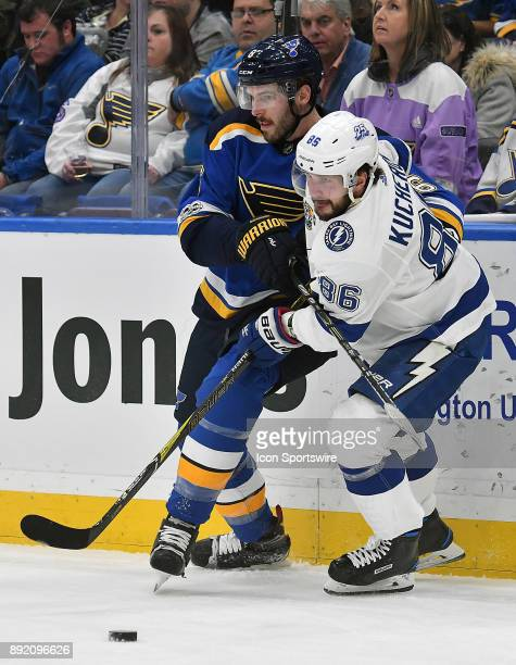 St Louis Blues defenseman Joel Edmundson and Tampa Bay Lightning rightwing Nikita Kucherov compete for the puck during a NHL game between the Tampa...
