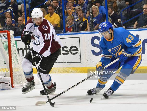 St Louis Blues defenseman Jordan Schmaltz battles for the puck with Colorado Avalanche defenseman Patrick Wiercioch during an NHL game between the...