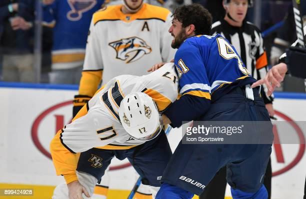St Louis Blues defenseman Robert Bortuzzo fights with Nashville Predators leftwing Scott Hartnell during a NHL game between the Nashville Predators...