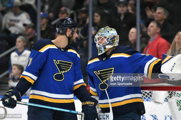 St Louis Blues defenseman Robert Bortuzzo talks with St Louis Blues goalie Jordan Binnington during a time out during an NHL game between the New...