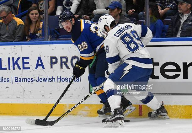 St Louis Blues defenseman Vince Dunn and Tampa Bay Lightning center Cory Conacher compete for the puck during a NHL game between the Tampa Bay...