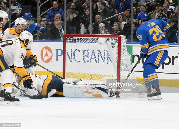 St Louis Blues defenseman Vince Dunn shoots and scores during an NHL game between the Nashville Predators and the St Louis Blues on February 09 at...