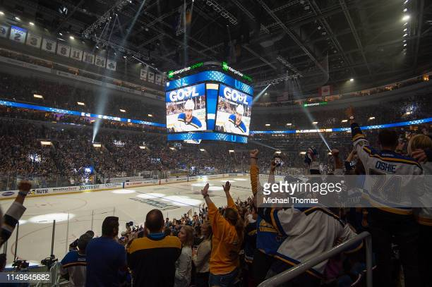 St. Louis Blues fans celebrate a St. Louis Blues goal in the third period at the Stanley Cup Final Game 7 Watch Party between the Boston Bruins and...