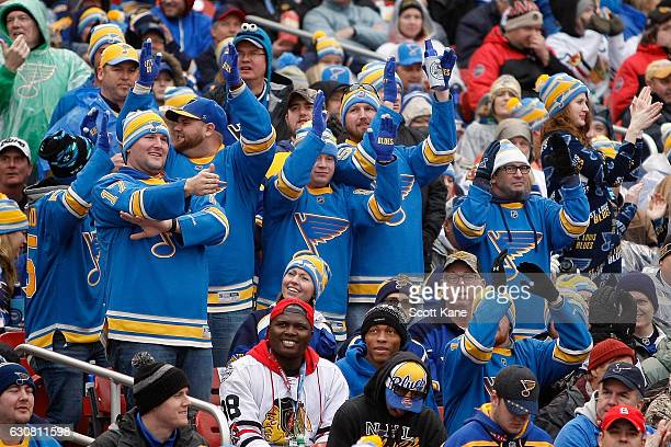 St Louis Blues fans cheer during a power play during the third period of the 2017 Bridgestone NHL Winter Classic against the Chicago Blackhawks at...