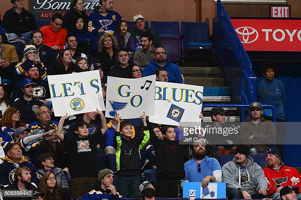 St Louis Blues fans hold up signs during a game against the San Jose Sharks at the Scottrade Center on February 4 2016 in St Louis Missouri