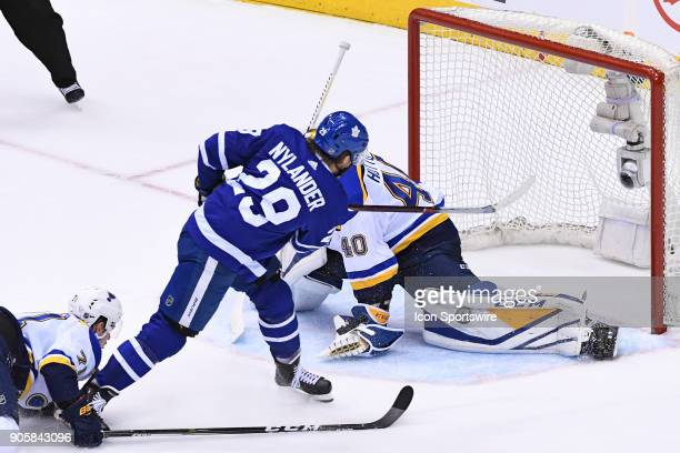 St Louis Blues Goalie Carter Hutton makes a pad save on Toronto Maple Leafs Right Wing William Nylander in overtime during the regular season NHL...