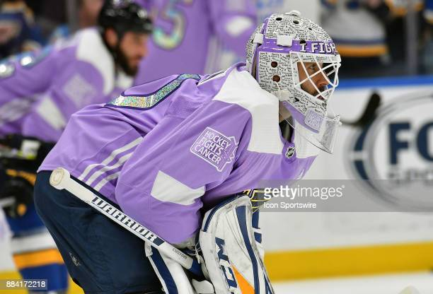 St Louis Blues goalie Carter Hutton wears a special Hockey Fights Cancer warmup jersey with special mask before a NHL game between the Los Angeles...