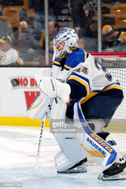 St Louis Blues goalie Jake Allen gloves a shot in warm up before a game between the Boston Bruins and the St Louis Blues on January 17 at TD Garden...