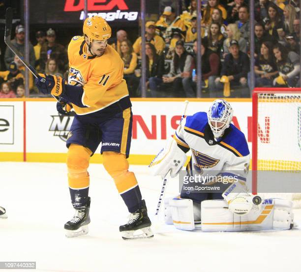 St Louis Blues goalie Jake Allen makes a save on the deflection by Nashville Predators center Brian Boyle during the NHL game between the Nashville...