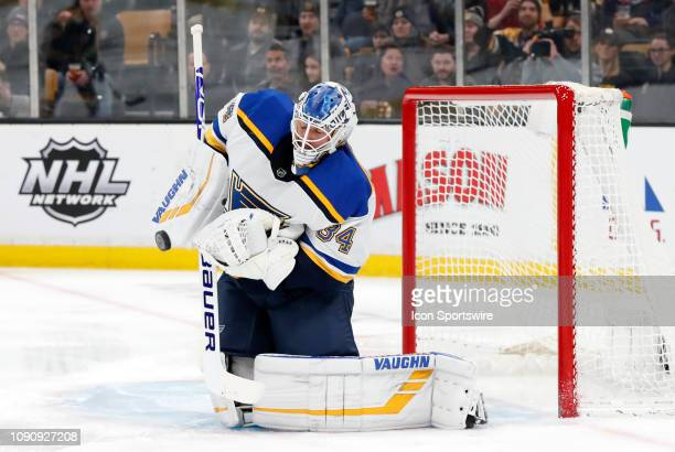 St Louis Blues goalie Jake Allen spills a shot during a game between the Boston Bruins and the St Louis Blues on January 17 at TD Garden in Boston...