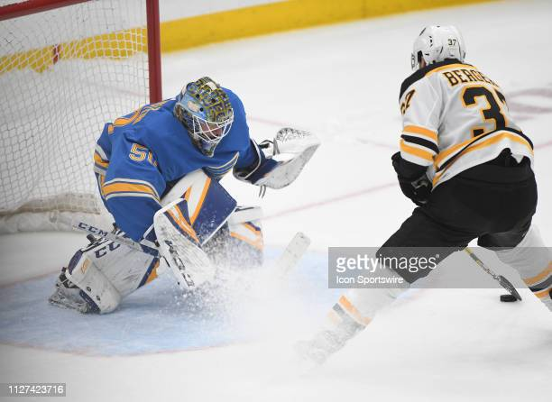 St Louis Blues goalie Jordan Binnington blocks an overtime shootout shot by Boston Bruins center Patrice Bergeron during a NHL game between the...