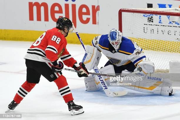 St Louis Blues goaltender Jake Allen blocks a penalty shot from Chicago Blackhawks right wing Patrick Kane in a shootout during a game between the...