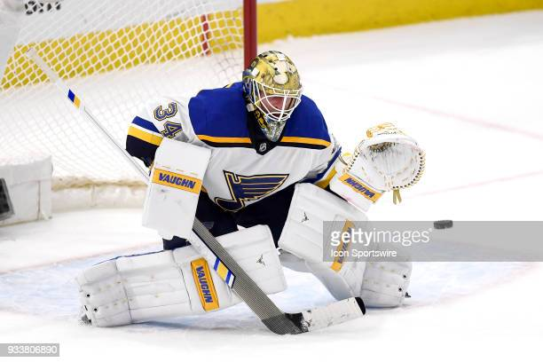 St Louis Blues goaltender Jake Allen blocks a shot in overtime play during a game between the Chicago Blackhawks and the St Louis Blues on March 18...
