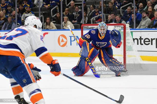 St Louis Blues goaltender Jordan Binnington gets ready to block a shot on goal by New York Islanders leftwing Anders Lee in overtime during an NHL...
