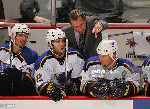 St. Louis Blues head coach Mike Kitchen gives instructions to Lee Stempniak and Keith Tkachuk in the third period at the Honda Center during the game...