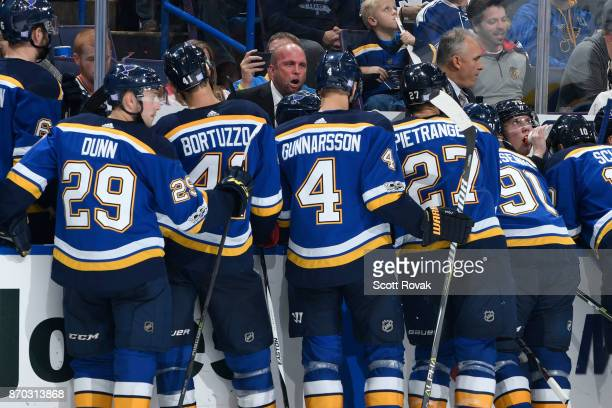 St Louis Blues head coach Mike Yeo addresses his players during a timeout against the Toronto Maple Leafs at Scottrade Center on November 4 2017 in...