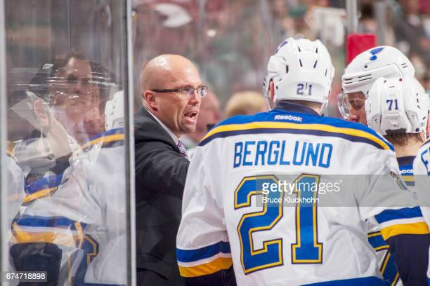 St Louis Blues head coach Mike Yeo instructs his team against the Minnesota Wild in Game Five of the Western Conference First Round during the 2017...