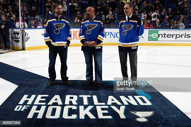 St Louis Blues honor former goalies Curtis Joseph Grant Fuhr and Mike Liut before a game against the Montreal Canadiens at the Scottrade Center on...